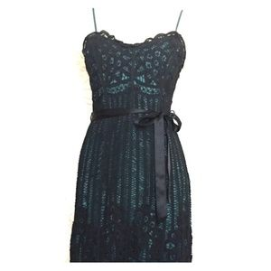 Black lace dress with teal lining.